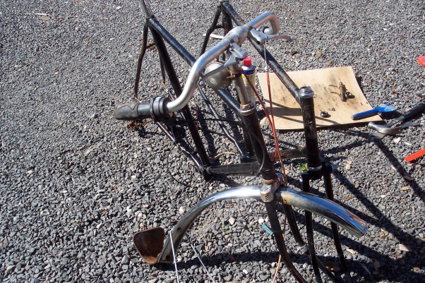 two stripped roadster frames