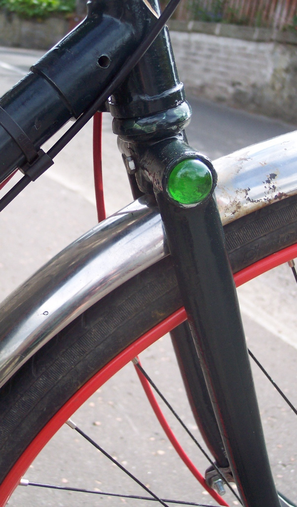 green glass insert in Raleigh fork-crown thimble