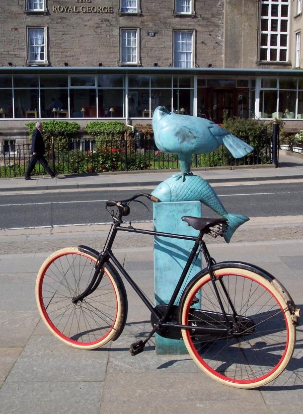 Sunbeam and fish sculpture