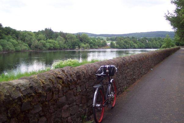 by the flood wall on the North Inch, beside the Tay