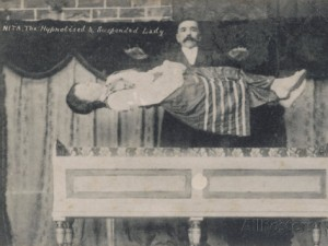 magician-performs-a-levitation-trick-on-stage-nita-the-hypnotised-and-suspended-lady