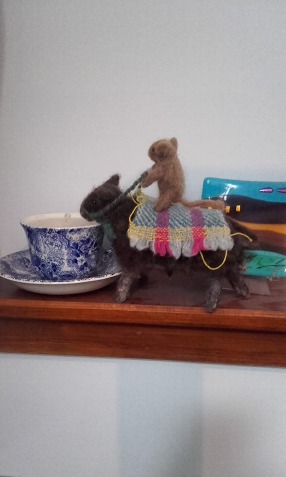 small and sheep on the mantelpiece